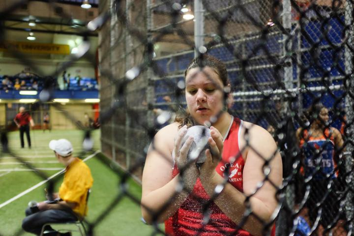 Michelle Mazza prepares for the shot put competition at Eastern States, Feb. 24, 2014.